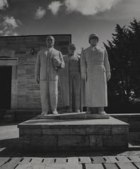 At constant attention (Linus Wärn) Tags: blackandwhite bw monochrome turkey mono blackwhite grain statues mausoleum ankara atatürk anıtkabir