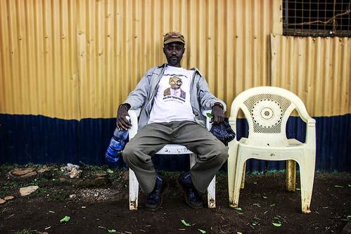 Man Chewing Qat on a Plastic Chair