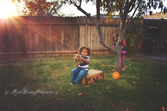 (Krista Cordova Photography) Tags: boy playing fall girl kids children fun sister brother hideandseek teddybear brotherandsister cutekids sisterandbrother hispanicchildren africanamericanchildren