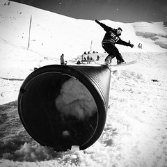 Back Tail No2 (Chris Tsanis) Tags: winter light bw sun white mountain snow black square snowboarding blackwhite ride tube style fisheye snowboard trick rider jib snowpark kalavrita helmos backlip snowcenter