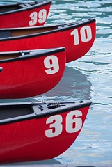 Red Kayaks with numbers (Mysophie08) Tags: canada blurred lakelouise banffnationalpark gamewinner mediumquality thechallengefactory fotocompetitionbronze storybookwinner drivingthrucanadianrockies vision:text=0549 vision:outdoor=0761