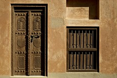 Door and window (dmjames58) Tags: door travel colour heritage window architecture canon antique uae ornate alain tradional vision:text=0774 vision:outdoor=0839