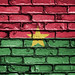 National Flag of Burkina Faso on a Brick Wall