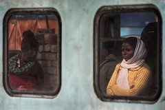 Being a woman (Feca Luca) Tags: street reportage window train station people woman donna riflesso travel outdoor india asia nikon varanasi