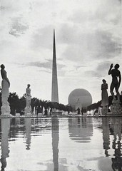 "The Trylon and Perisphere at the 1939 New York World's Fair. In the foreground are ""The Four Freedoms"" by Leo Friedlander (lhboudreau) Tags: brochure photobook book pamphlet softcover fair worldsfair newyorkworldsfair exhibition 1939 1939worldsfair 1939newyorkworldsfair internationalexhibition newyork newyorkcity art artwork bookart giftbook souvenir souvenirbook 1940 1940edition illustratedbycamera manhattanpostcardpublishingco manhattanpostcardpublishingcompany statue sculpture statues sculptures artdeco trylon perisphere fourfreedoms thefourfreedoms friedlander leofriedlander pool water reflectingpool souvenirphotobook sphere obelisk ball giantball whiteball hollowball hollowwhiteball gianthollowwhiteball hollowsphere giantsphere whitesphere hollowwhitesphere gianthollowwhitesphere"
