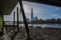 Under Cannon Street rail bridge (Spannarama) Tags: shard supports struts beams foreshore riverbed architecture buildings framed cannonstreetrailbridge bridge river thames londonbridge buses southwarkcathedral london uk blueskies samyang12mm