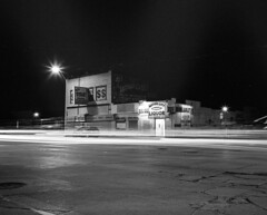 Detroit at Night (IV2K) Tags: detroit michigan mamiya7ii mamiya7 kodak kodaktrix trix blackandwhite bw longexposure lighttrails motorcityshooters nothingstopsdetroit liquor liquorstore film analogue mediumformat