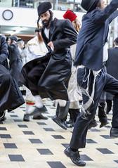 """When Adar enters, joy increases"" (ybiberman) Tags: israel jerusalem meahshearim jews ultraorthodox purim feast festival man men dancing jumping celebrating party payot hat candid portrait streetphotography people"