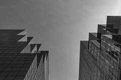 Geometric Skyscapers (SNAPShots by PJW *Join LNP*) Tags: bw blackwhite bnw monochrome noiretblanc windows architecture buildings reflections outside lines patterns texture sunny bright shadows light city street shapes exposure detail depthoffield dof