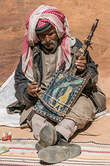Bedouin Man Playing the Oldest String Instrument in the Siq at Petra (Gordon Magee) Tags: stringedinstrument petra man bedouin thesig