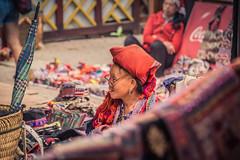 Elderly woman selling clothes at market in Sapa, Vietnam (yann_j) Tags: voyage portrait asia travel streetvendor woman elderly vietnam sapa