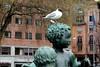 every statue has its bird (overthemoon) Tags: norway norvège norwegen oslo urban art townhallsquare radhus statue child bird building brick utata:project=tw574