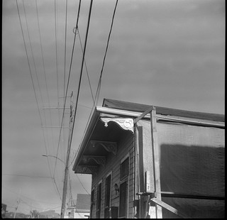 residence, construction, powerlines, Uptown, New Orleans, Louisiana, Zeiss Ikon Nettar, Arista.Edu 400, Ilford Ilfosol 3 developer, late April 2017
