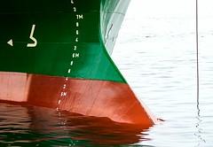 Hull (Karen_Chappell) Tags: ship boat metal paint painted water harbrour maritime marine green orange red ocean stjohns canada atlanticcanada atlantic reflection abstract ripples liquid numbers