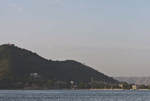 Cartoon - View of the water of the Fateh Sagar Lake in Udaipur, along with hill