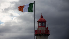 the lighthouse of Dn Laoghaire (diwan) Tags: city ireland lighthouse clouds geotagged place harbour flag wolken irland hafen fahne leuchtturm eastpier dnlaoghaire republicofireland ire poblachtnahireann canoneos650d countydnlaoghairerathdown geo:lon=6126572 geo:lat=53302320