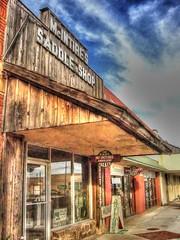 Saddle Shop (podolux) Tags: newmexico southwest shop nikon roadtrip storefront nm shopfront southwesternunitedstates saddlery photomatix landofenchantment theamericansouthwest tonemapped tonemap saddleshop photomatixformac