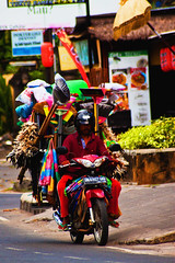 Travelling Salesman. (Triple_B_Photography) Tags: elementsorganizer bali travel holiday indonesia sanur local tourism sight motorcycle packing crazy humerous funny hardwork lucu saturation color colour vibrant man helmet asia