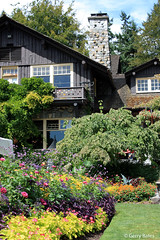Stanley Park Pavillion (gerry.bates) Tags: park trees windows summer chimney urban plants canada building architecture vancouver canon garden flora bc stones britishcolumbia masonry structure roofs stanleypark wisteria perennials climbingplant annuals flowerbeds