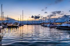 Puesta de sol el puerto deportivo de Cambrils / Sunset in the Cambrils marina (aldairuber) Tags: sunset mediterraneo puestadesol crepusculo cambrils tarragona mediterraneansea goldcoast costadorada twitlight