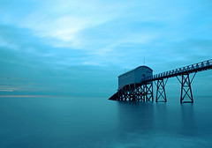Selsey Lifeboat Station at Dawn (Simon Verrall) Tags: uk longexposure morning november blue winter sea seascape beach sunrise landscape dawn sussex pier seaside westsussex horizon lifeboat selsey lifeboatstation 2013 selseybill