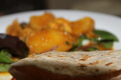 Chicken and potato curry with chapatis (WorldClick) Tags: red food chicken canon bread eos photo salad flickr photographer mesh sauce burger indian cress sausage continental chips potato photograph pakistani spicy chilli coriander nan tartar jalapenos kebabs chapatis masalas aloo phototgraphy 1100d canoneos1100d worldclick