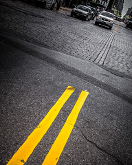 city street (little~ny) Tags: road street city nyc newyorkcity urban lines car yellow traffic manhattan ground cobblestone asphalt avenue automobiles