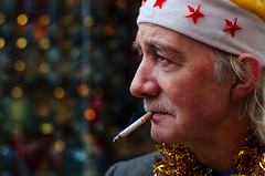 Smoke Break (Charles Hamilton Photography) Tags: christmas portrait people face festive 50mm colours expression glasgow cigarette smoke streetportrait buchananstreet smoking performer santahat busking clarinet characterstudy peopleinthecity clarinetplayer festivecolour colourstreetportrait nikond7000 glasgowcharacter glasgowstreetportrait