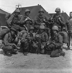 Soldiers posing with their guns and gear (simpleinsomnia) Tags: old white black monochrome vintage dark found army blackwhite war antique african snapshot posing gear rifles photograph american africanamerican soldiers vernacular guns foundphotograph