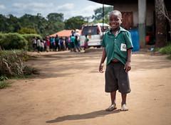 School boy. (Dan Fleury) Tags: future hope happy shoeless dusty education school pearofafrica eastafrica africa mityana uganda boy smile uniform shoes barefoot dirt content cute culture