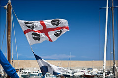 castelsardo (heavenuphere) Tags: castelsardo sassari sardegna sardinia sardinie italia italy europe island harbour marina boat yacht sardinian flag 24105mm