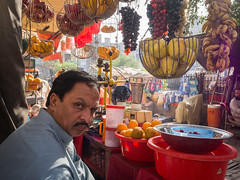 Fruit Seller - Peshawar- Pakistan (Shahid A Khan) Tags: pakistan peshawar street photography fruit seller kyberbazaar kpk khyberpukhtoonkhuwa qissa khuwani olympus travel stare