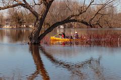 Heading Upriver (Anvilcloud) Tags: carletonplace flooding mississippiriver riversidepark canoe