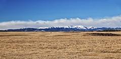 Alberta Rockies Spring (John Andersen (JPAndersen images)) Tags: alberta chinook cloud fence prairie ranch road rockies sky spring west