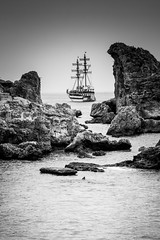Pirate rocks (Anthony P26) Tags: antalya category marina places seascape travel turkey turkiye tourboat rocks stones transport ship sailboat canon1585mm canon70d canon coast coastline coastal sea sky greysky water mediterranean waves blackandwhite whiteandblack monochrome bw