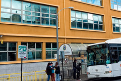 In case of Tsunami (LeftCoastKenny) Tags: chile patagonia day16 puntaarenas building bus people sign text reflections