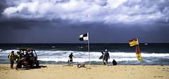"""Debbie"" does Austimer. (TOXTETH L8) Tags: debbie cyclone austimer newsouthwales australia lifesavers flags sand pacificocean beach beachbuggy clouds wind rain storms floods deaths"