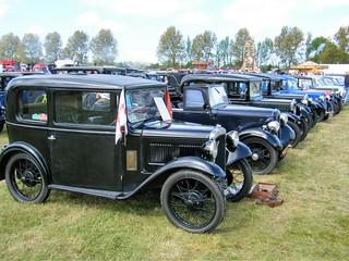 An large array of vintage Austin cars