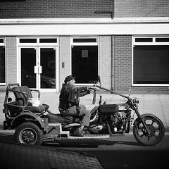 IMG_2234 (Kathi Huidobro) Tags: southlondon merton disabilityscooter pimpmyride characters eccentric chariot motorbike customisedmotorbike london streetphotography candid bw monochrome blackwhite