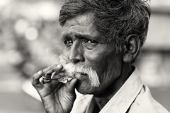 India, old man with cigarette (Dietmar Temps) Tags: asia beard cigarette culture ethnic ethnie ethnology face india madurai naturallight oldman outdoor people portrait smoking south streetphotography tamilnadu tradition traditional