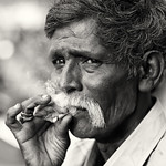 India, old man with cigarette thumbnail