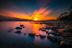 8 minutes of relaxation! (Edgar Myller) Tags: sunset water long exposure stone rock blue sky orange red yellow forest porkkala nature landscape beach coast sea seascape maisema auringonlasku nd filter polarizer