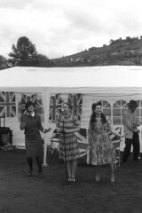 The Honeybirds performing in the park (Julian Dyer) Tags: vintage blackwhite events yorkshire 35mmfilm ilforddelta400 fujicast705 haworth ilfordddx haworth1940sweekend haworth1940s