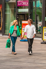 Beautiful People Coordinate Their Plastic Shopping Bags.jpg (Pauls-Pictures) Tags: street city two people urban netherlands shopping photography couple candid streetphotography style lovers matching chic photograhy almere streetphotos streetpics streetphotograhy streetpictures bagshoppers