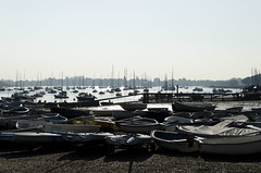 Itchenor boats silhouetted against the morning sun as the tide comes in (skipnclick) Tags: morning water silhouette boats nikon harbour tide shingle hard jour stillness contra chichester itchenor 18200mm d7000