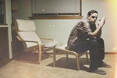 Self (Chris Meium Photography) Tags: light portrait film ikea minnesota self canon chair apartment grain cities stpaul twin boom mpls tc levi vans twincities leak mn 1740l uwa 50d strobist 430exii