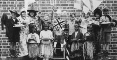 The Play - The Empire (theirhistory) Tags: girls england boys playground flags dressingup