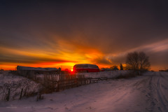 A Country Vision 8229_13 (IanDMcGregor) Tags: winter snow canada tree beautiful beauty barn rural sunrise fence photography dawn nikon farm country rustic footprints rays prairie saskatchewan d800 melville canadianphotographer ianmcgregor ianmcgregorphotographycom vision:sunset=0952 vision:sky=099 vision:outdoor=0975 vision:clouds=0977