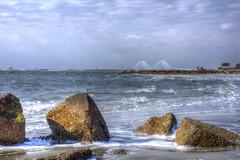 Charleston Harbor (Mike Beauchamp) Tags: ocean travel bridge water rocks day waves cloudy charleston charlestonsc charlestonharbor arthurraveneljrbridge