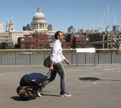 man by st pauls (seligr) Tags: uk sunlight man london thames river walking shadows stpauls cathedrals walker walkway gb milleniumbridge railings suitcases travelbags